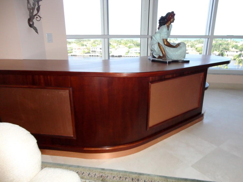 Dark wood veneering in-home furniture