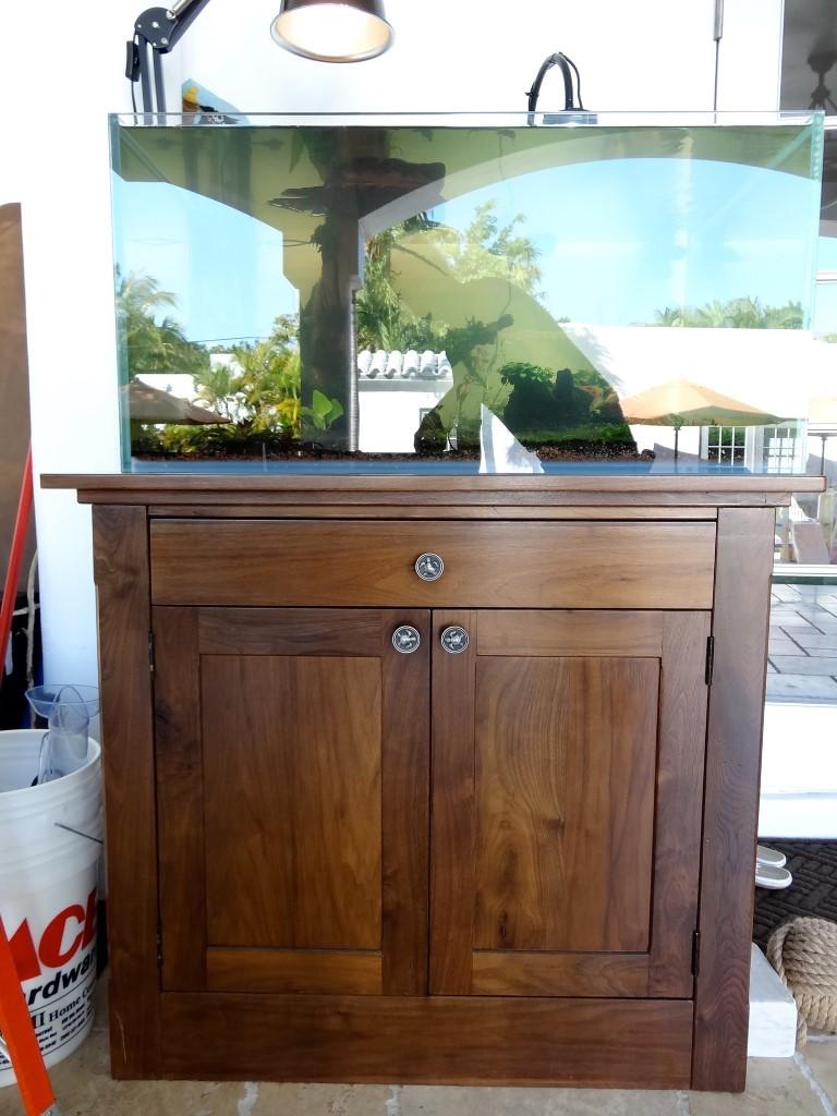 Front of custom walnut aquarium base cabinet