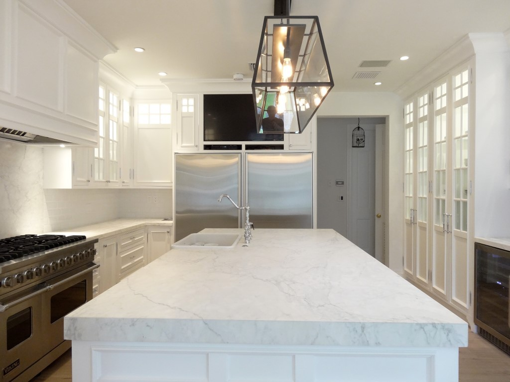 Large white slab marble kitchen island for mansion with kitchen cabinets
